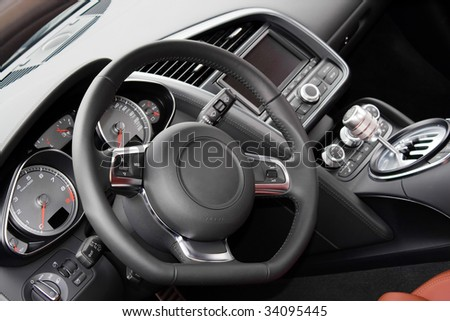 The interior of a modern luxury sports car - stock photo