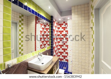 The interior of a small colorful bathroom - stock photo