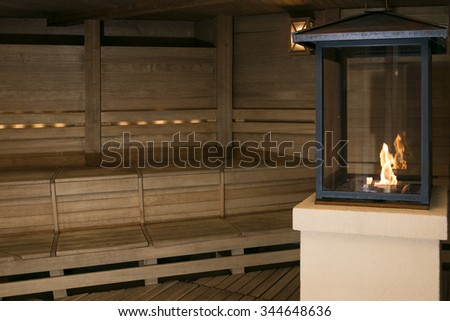 the interior of a small wooden sauna booth in a spa