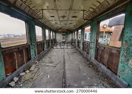 The interior of an abandoned railway wagon - stock photo
