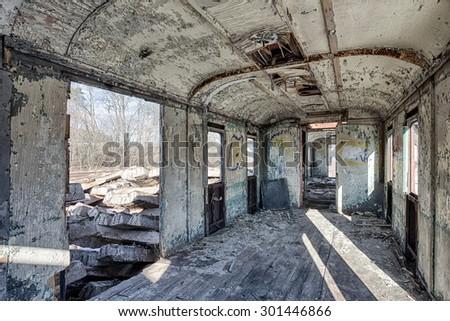 The interior of an abandoned railway wagon - stock photo