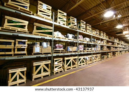The interior of an industrial manufacturer's warehouse. - stock photo