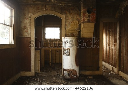 The interior of an old abandoned house on a farm. - stock photo