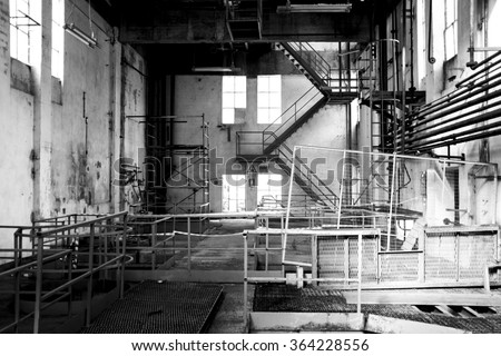 The interior of an old abandoned machine hall, with the control room - stock photo