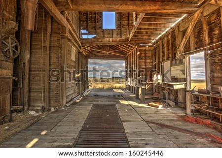 The interior of an old vintage wooden grain elevator. Processed using HDR. - stock photo