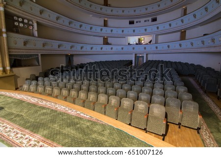The interior of the theater's auditorium Decoration of the theater hall, balconies, armchairs, lamps and chandeliers