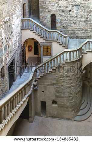 The interior with the great stairs of a medieval castle of Counts Guidi in the historic small medieval town of Poppi, Tuscany (Italy) - stock photo