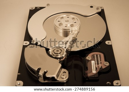 The internal hard disk read head and the cylinder - stock photo