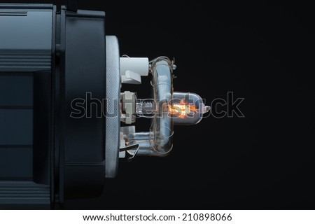 The internal structure of switched spotlight side view. Isolated on black background - stock photo