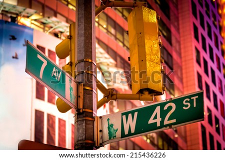 The intersection of 42nd Street and 7th Avenue at Times Square, New York City. - stock photo