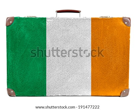 The irish flag painted on old grungy travel suitcase or trunk