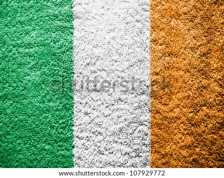 The irish flag painted on towel surface