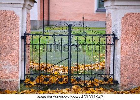 The iron gate entryway to a Swedish church yard. - stock photo