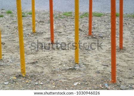 The iron labyrinth on the playground and the support of the horizontal bar. Summer background