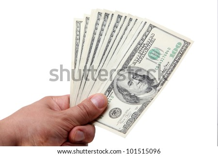 The isolated hundred dollar denominations in a hand - stock photo