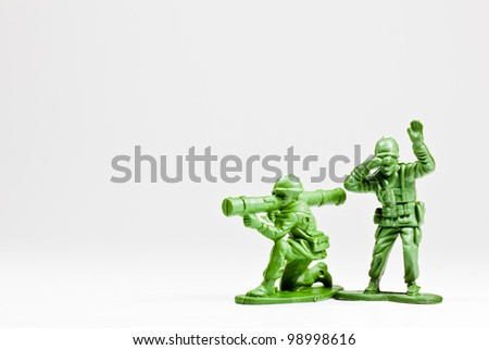 The isolated image of two green plastic toy soldiers