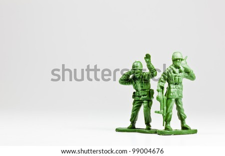 The isolated image of two green plastic toy soldiers - stock photo