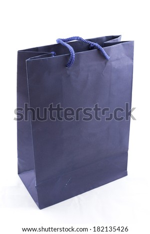 the isolated of the blue paper bag for shopping on a white background