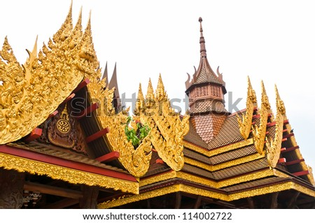 The isolated picture of the top of Thai style roof.This is traditional and generic style in Thailand.
