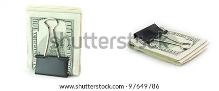 The isolated pile of 100 dollar denominations in a writing clip - stock photo