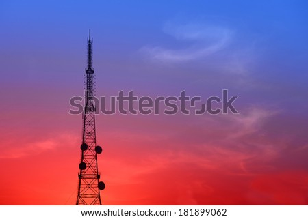 The isolated radio towers in the sunset   - stock photo