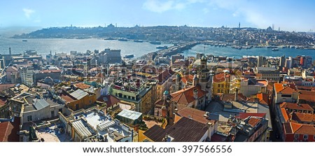 The Istanbul cityscape from Galata Tower with the Golden Horn Bay, Galata bridge and historic Fatih district, Turkey. - stock photo