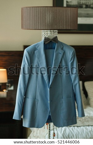 the jacket and tie of the groom