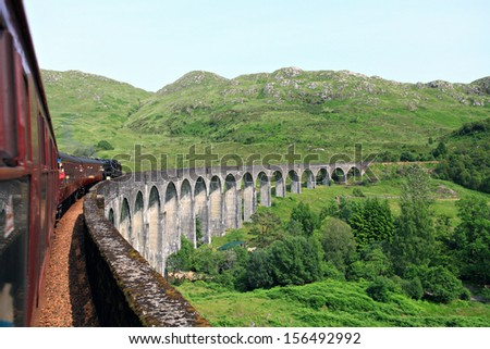 The Jacobite train crossing the Glenfinnan viaduct. - stock photo