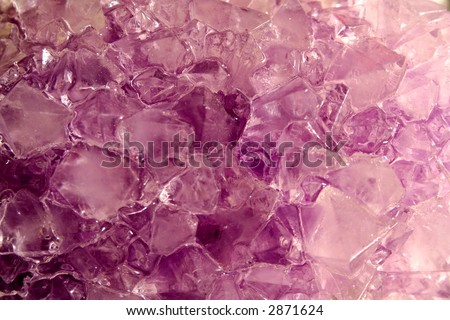 The jagged and glittering surface of quartz crystals. - stock photo