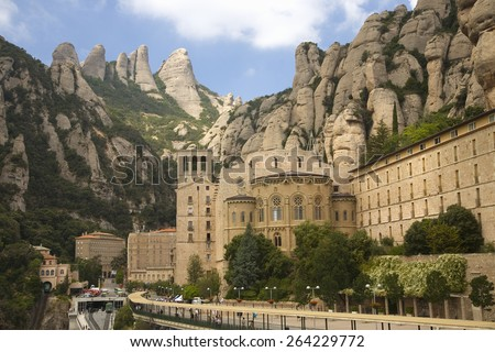 The jagged mountains in Catalonia, Spain, showing the Benedictine Abbey at Montserrat, Santa Maria de Montserrat, near Barcelona, where some feel the Holy Grail had been - stock photo