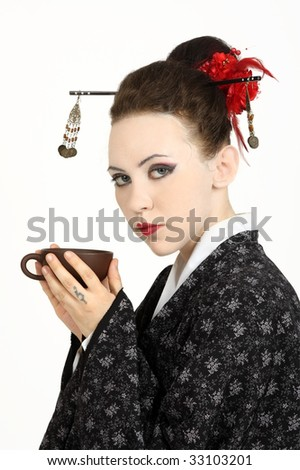 The Japanese geisha on a white background with a fan and an umbrella