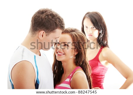The jealousy girl against young couple, isolated on white - stock photo