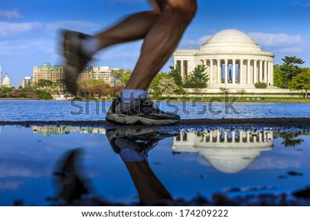 the Jefferson Memorial during the Cherry Blossom Festival. Washington, DC with runner. - stock photo