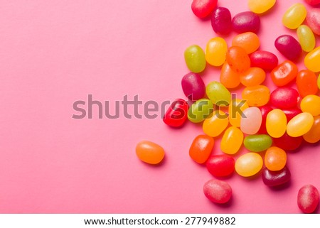 the jelly beans on pink background - stock photo