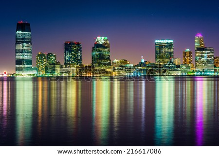 The Jersey City Skyline at night, seen from Pier 34, Manhattan, New York.