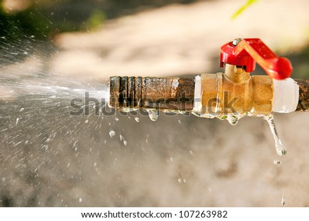 The jet spray of water from a water tap. - stock photo