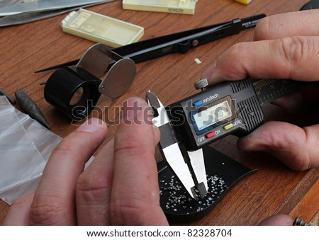The jeweler is working at jeweler's workshop - stock photo