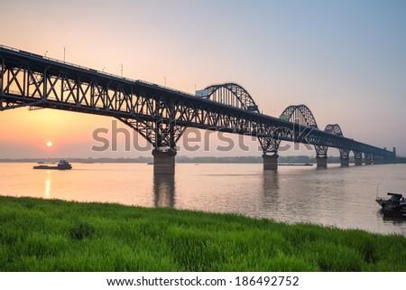 the jiujiang yangtze river bridge in sunset,jiangxi province ,China  - stock photo
