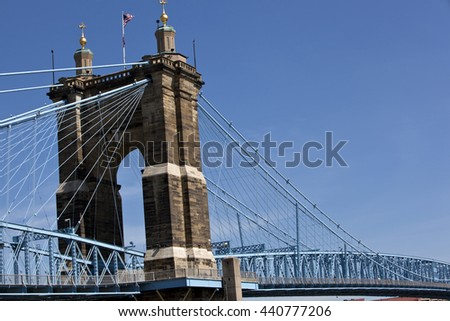 The John A. Roebling Bridge connects Cincinnati, Ohio and Covington, Kentucky over the Ohio river. - stock photo