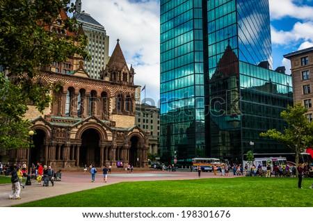 The John Hancock Building and Trinity Church at Copley Square in Boston, Massachusetts. - stock photo