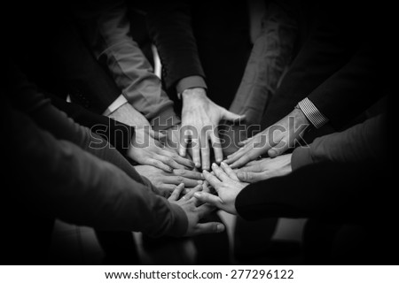 The joined hands of a group of people - stock photo