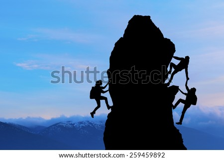 The joint work teamwork of two men travelers help each other on top of a mountain climbing team, a beautiful sunset landscape - stock photo