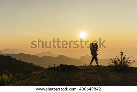 The joy of father and son Family happy Silhouette view sunset twilight color at Phu Chi Fa Mountain Thailand
