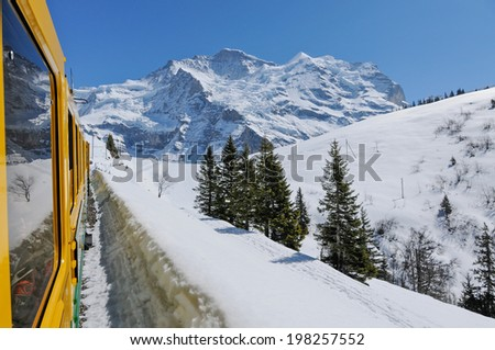 The Jungfrau Banh, is a train climbing all the way to the top of the Jungfrau at 3454 meters. It is the highest train station in the world - stock photo