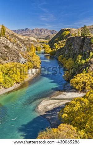 The Kawarau River flows from Lake Wakatipu through the gorge to Cromwell and Lake Dunstan in Otago, New Zealand. The gorge is seen here in autumn.