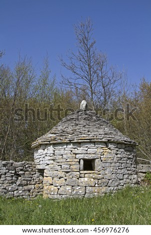 The Kazun is a small stone house in the Istrian countryside, which offered the shepherds and animals protection from the weather. - stock photo