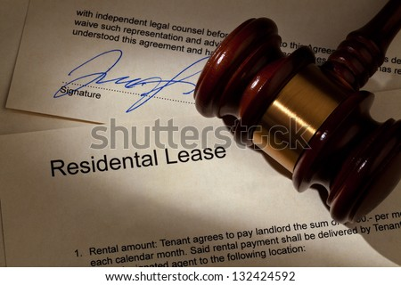 the key to an apartment and a lease in german - stock photo