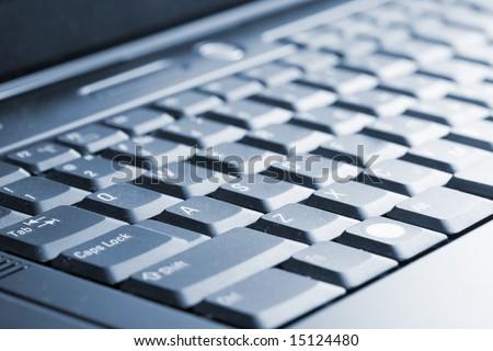 The keyboard modern laptop close up - stock photo