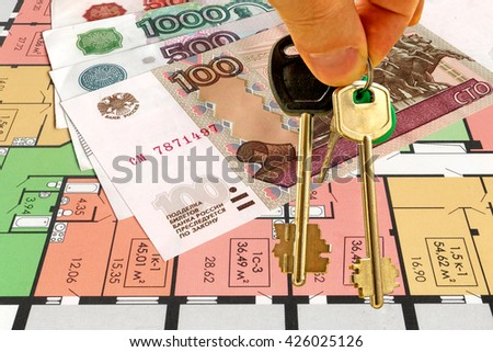 The keys and the drawing of a new residential building - stock photo