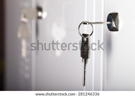 the keys in the keyhole closeup - stock photo